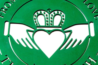 the claddagh symbol: two clasped hands (friendship) holding a crowned (loyalty) heart (love)